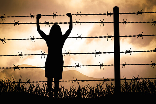 woman on barbed wire fence