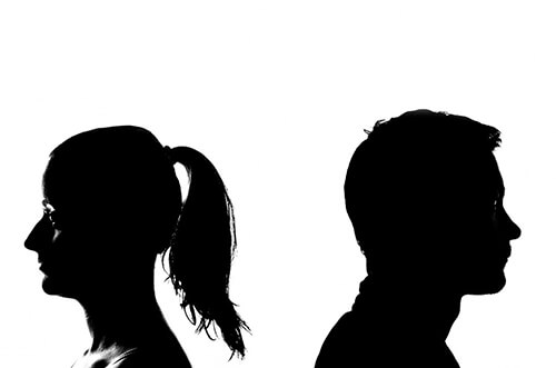 silhouettes of people struggling in a relationship