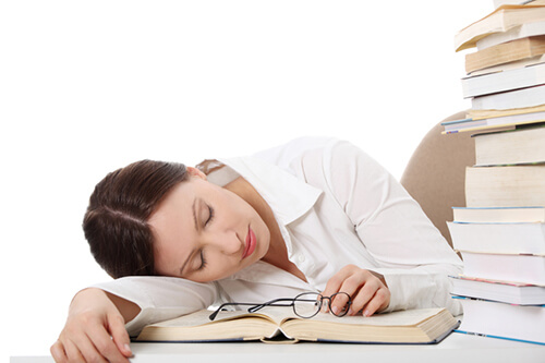 woman falling asleep reading a book